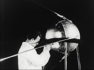A Russian scientist with the pre-launch Sputnik.