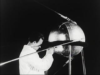 A Russian scientist with the pre-launch Sputnik.