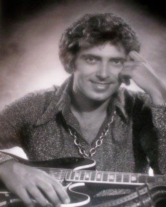"Guitarist and singer Duke ""Dukett"" in the '70s with his guitar in a promo shot"